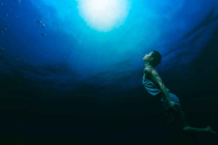 painting of a person swimming underwater